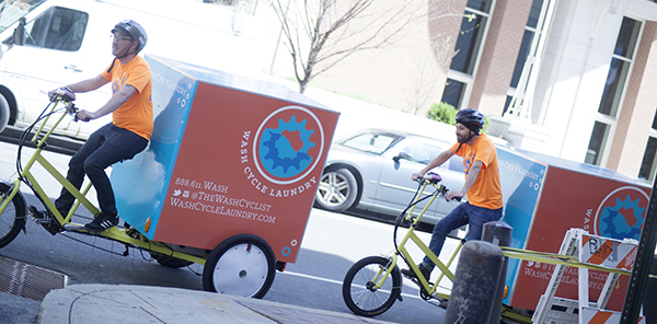 Wash Cyclists on the move. The new fleet of trikes can haul loads of up to 500 pounds.