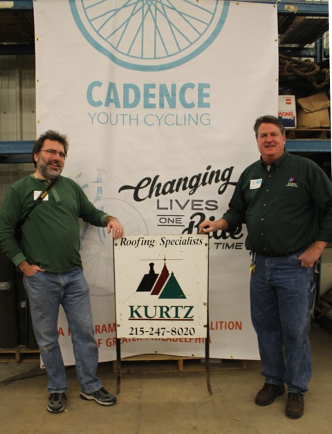 Bicycle Coalition executive director Alex Doty and Kurtz Construction warehouse supervisor Kevin Reilly