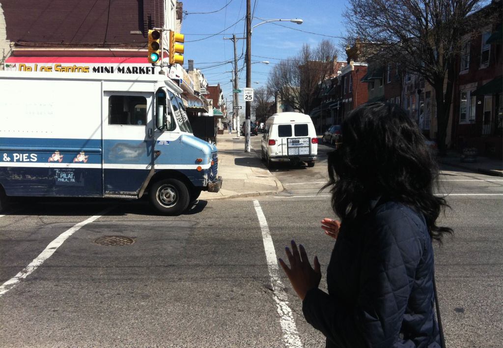 A van partially blocks a crosswalk around the corner from Wright.