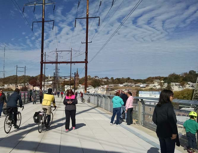Manayunk Bridge opening day in 2015 shows kid with helmet, families, and bicyclists enjoying the victory of our advocacy