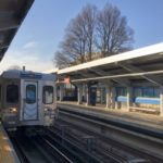 A Market Frankford line train pulls into a station