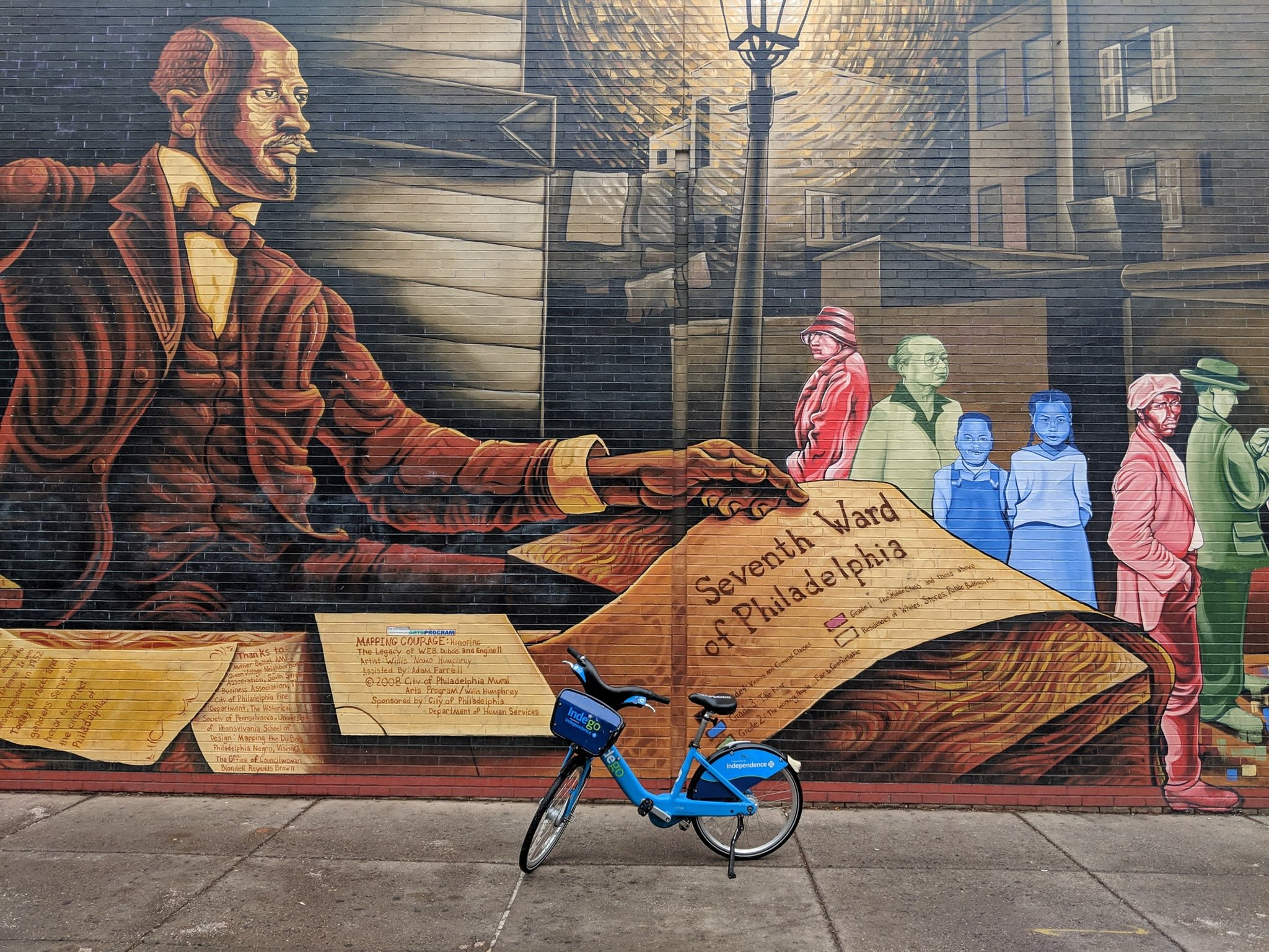 Indego bike in front of mural