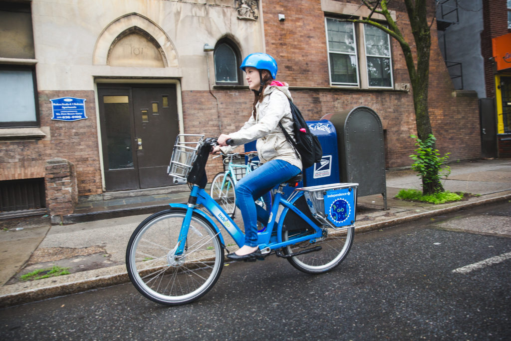 Person riding an Indego bike in Philadelphia