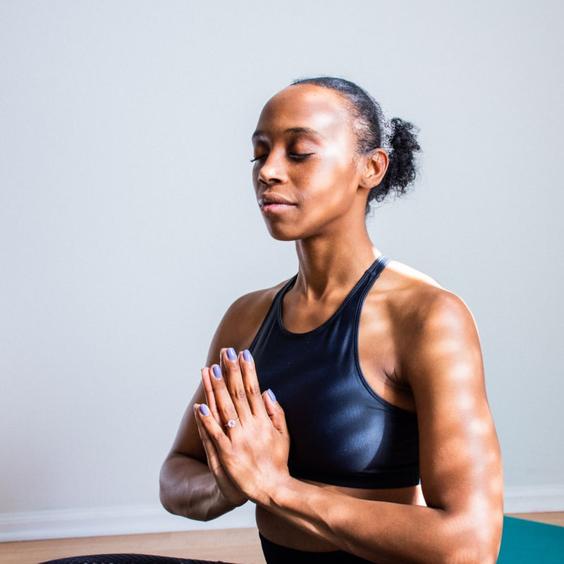 Person doing yoga with hands at heart center